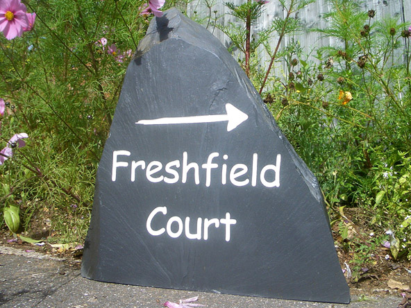 massive free standing house sign with directions