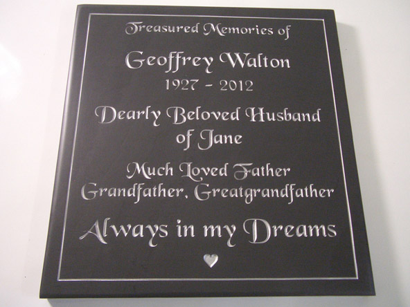 Slate plaque with engraved decorative border.