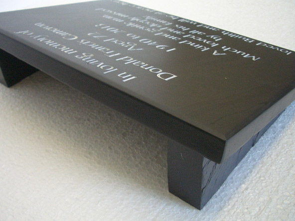 Slate memorial plate with side supports.