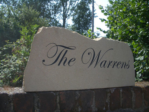 the warrens york sign